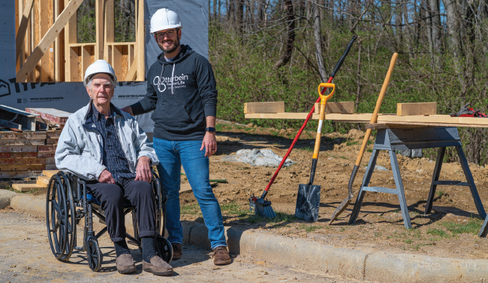 Otterbein Union Small House under construction with future Otterbein Union Small House resident in a wheel chair and staff member.