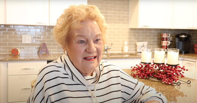 Otterbein Lebanon resident Beverly A. smiling sitting at an island in her kitchen.