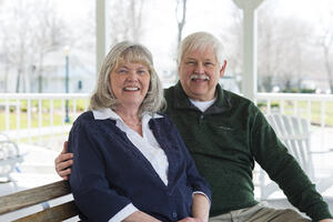 Happy retired couple sits outside