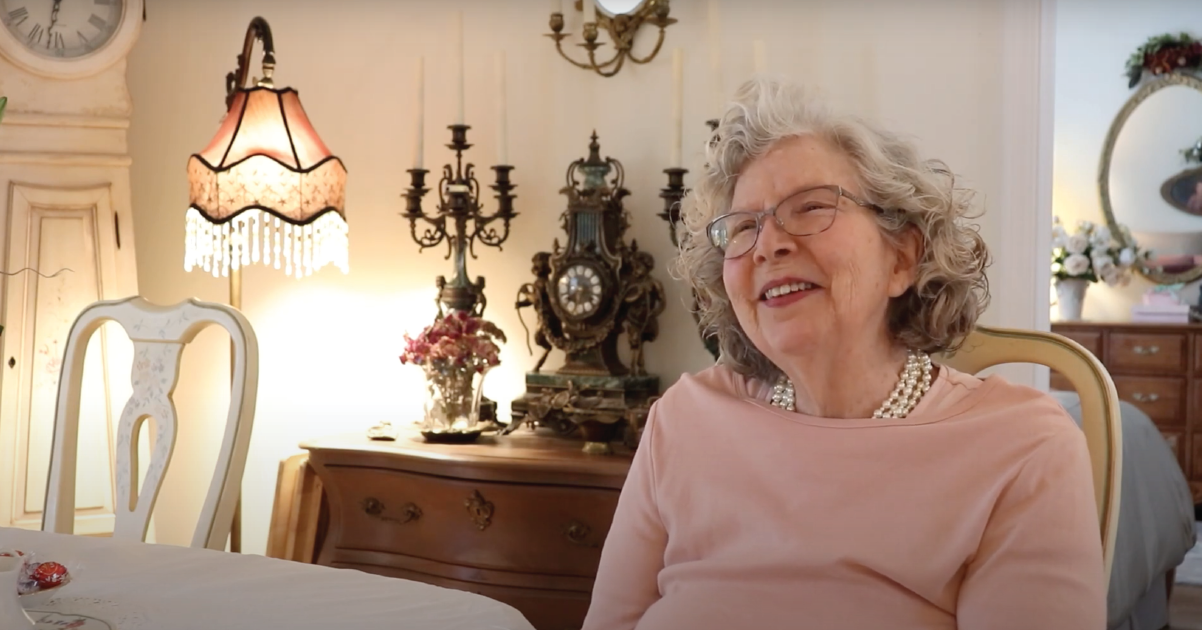 Otterbein Lebanon resident Marilyn M. smiling while sitting at her dining room table.