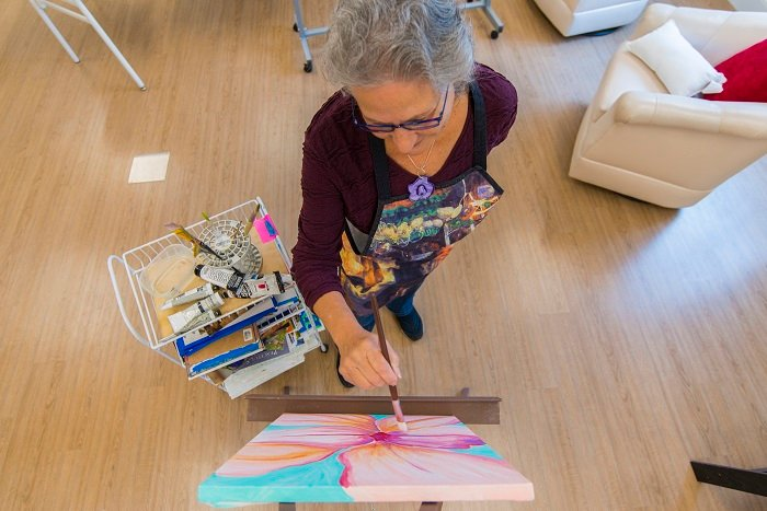 Woman at Otterbein SeniorLife paints on a canvas