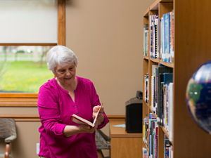 Otterbein resident reads book from library