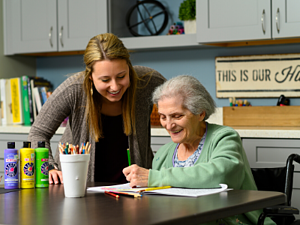 Senior loved one participates in a creative activity during a respite care stay at otterbein seniorlife