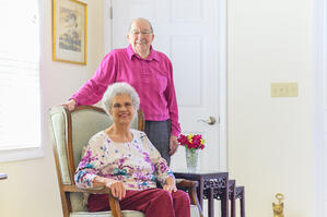 Senior man visits his wife in assisted living