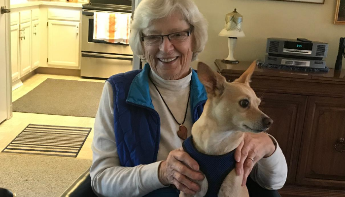 Otterbein Pemberville resident Joan H. sits with her dog in her independent living apartment