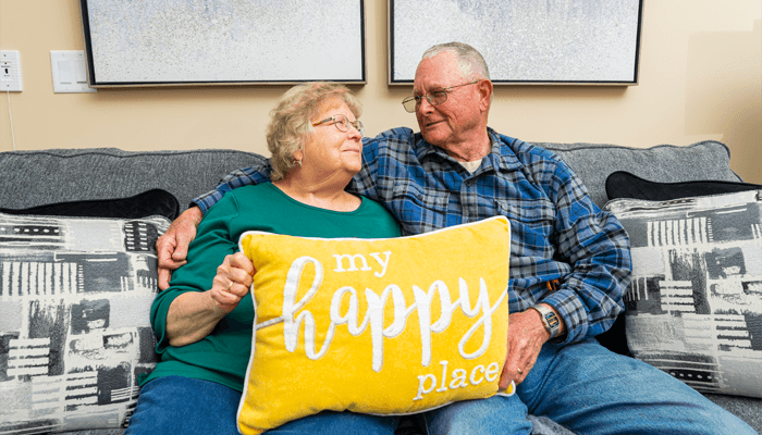 Happy senior couple sitting together on the couch