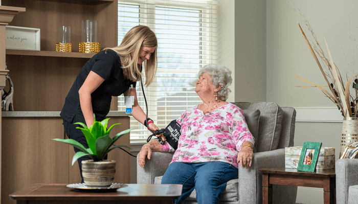 An Otterbein SeniorLife partner assists a resident in assisted living with ADLs.