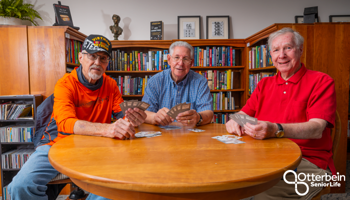 Three Otterbein residents play cards.