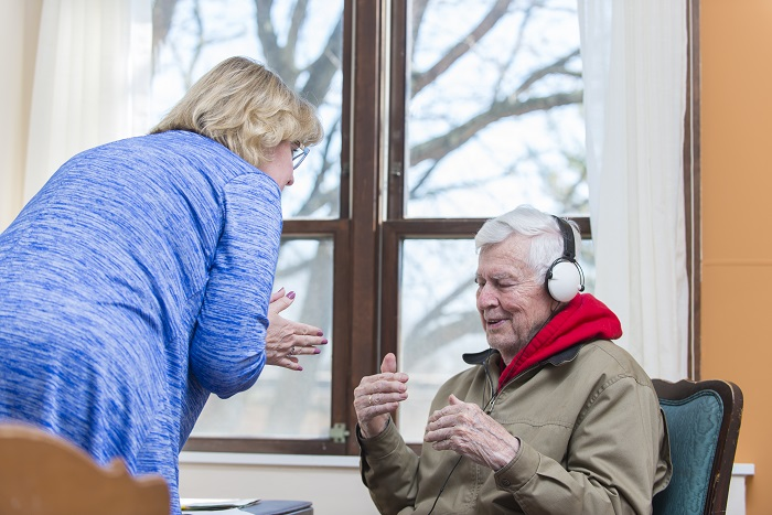 Caregiver and resident listen to music